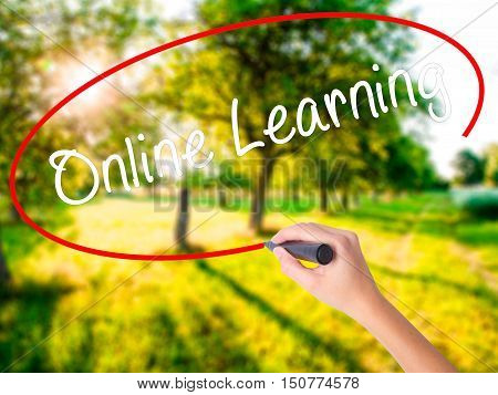 Woman Hand Writing Online Learning With A Marker Over Transparent Board
