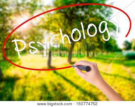 Woman Hand Writing Psychology With A Marker Over Transparent Board