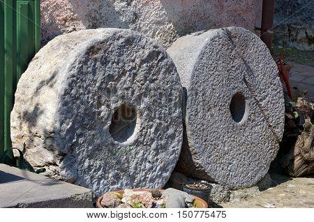 Two old millstones in the small village of Montemarcello La Spezia Liguria Italy Europe