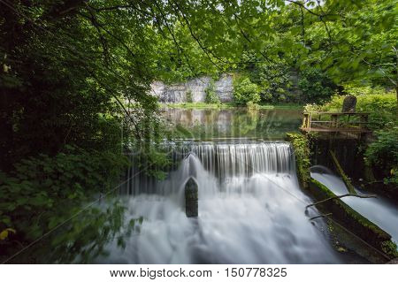 Cressbrook Weir and a millpond in the Peak District Derbyshire