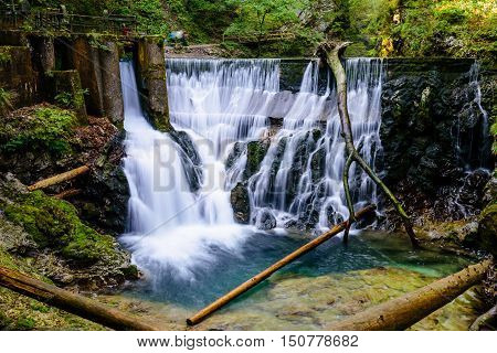 Waterfall at the Vintgar gorge, beauty of nature, with river Radovna flowing through, near Bled, Slovenia.