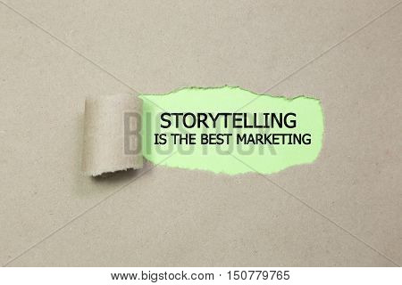 The motivational quote Storytelling is the best Marketing, appearing behind torn paper.