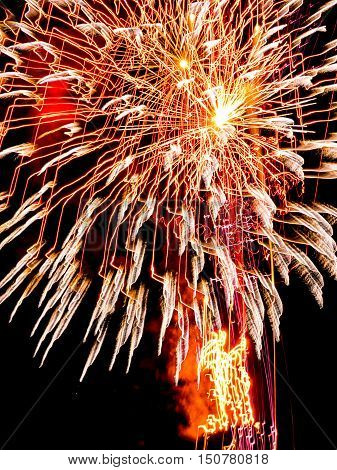 Large Golden burst sparkles.Spectacular fireworks  at a national fireworks championship  at Belvoir Castle. Three of the UK best firework companies compete with a 10-minute firework display.
