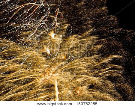 Golden sparkle. Spectacular fireworks  at a national fireworks championship in its ninth year at Belvoir Castle. Three of the UK best firework companies compete with a 10-minute firework display.