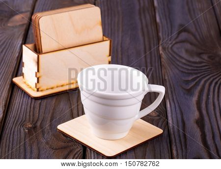 wooden stands and empy hot cups on wooden table