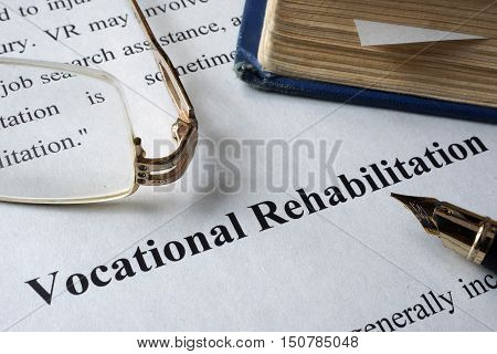 Vocational Rehabilitation written on a paper and a book.
