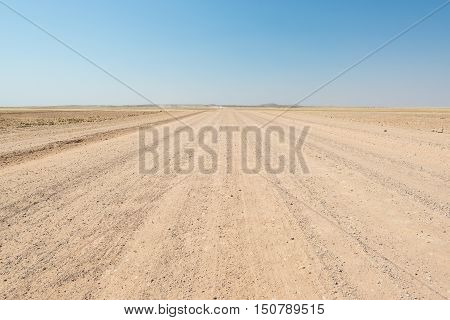 Gravel Straight Road Crossing The Colorful Namib Desert, In The Majestic Namib Naukluft National Par