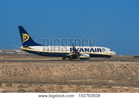TENERIFE SPAIN - JULY 21: Boeing 737 8 AS from Ryanair airline is ready to take off from Tenerife airport on July 21 2016 in tenerife south Spain.