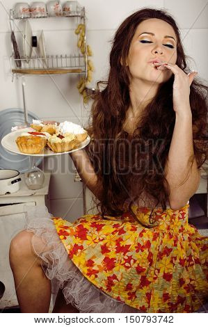 crazy real woman housewife on kitchen, eating perfoming, bizare girl halloween dress