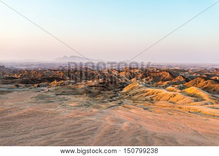 Sunset Light Over Barren Valleys And Canyons, Known As