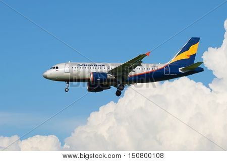 SAINT PETERSBURG, RUSSIA - AUGUST 24, 2016: Airbus A319-111 VP-BNJ) Donavia airlinesout of the clouds
