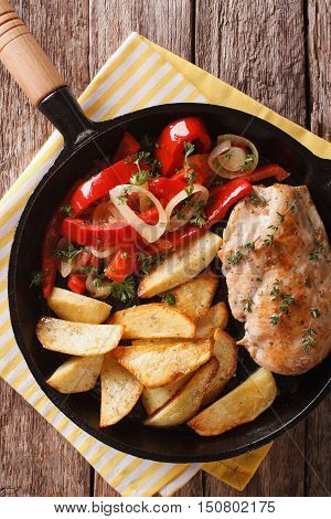 Sizzling Chicken With Roasted Potatoes And Pepper Close-up On A Pan. Vertical Top View