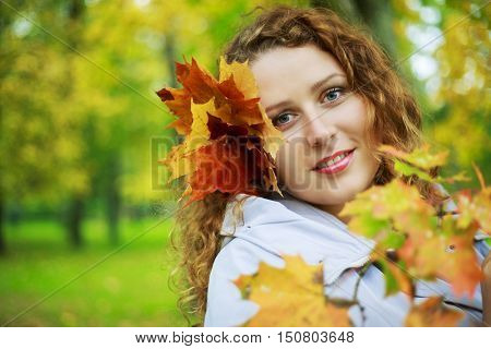 beautiful young plussize model in the autumn park