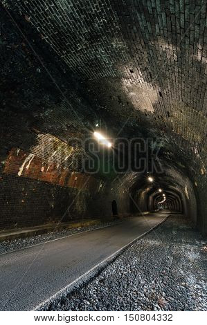 A disused train tunnel called Monsal Trail Tunnel between Buxton and Bakewell in the Peak District Derbyshire