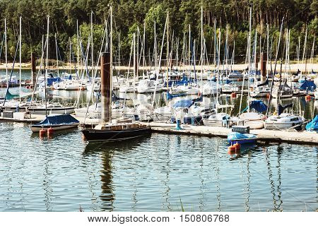 Many sailboats at the pier in Brombachsee Germany. Summer vacation. Travel destination. Beautiful place.
