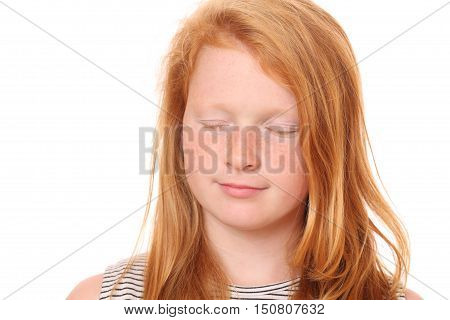Portrait of a thinking young girl on white background