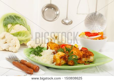 Domestic kitchen - breaded and fried cauliflower with grated cheese on green plate