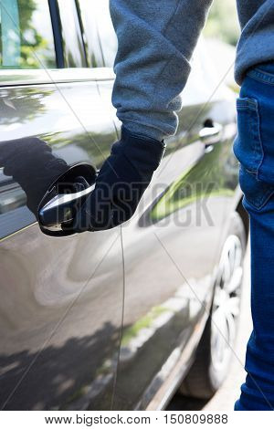 Car Thief Trying Door Handle To See If Vehicle Is Locked
