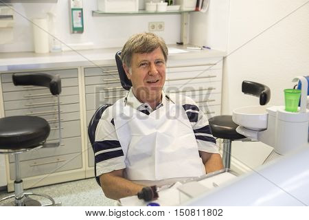 man at the dentist for a precaution session