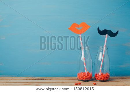 Valentine's day creative romantic background with retro bottles and strows
