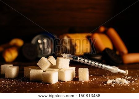 Disease - diabetes. Sugar syringe for injection harmful food