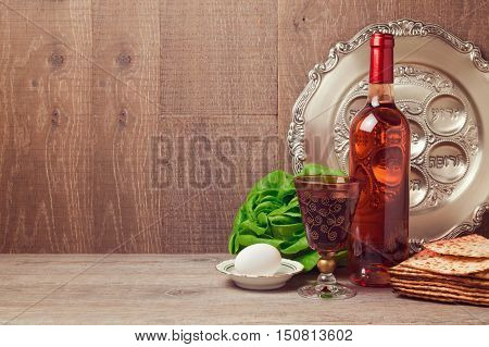 Passover background with wine bottle matzoh egg and seder plate