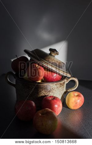 Fresh apples from a orchard in the clay pot.