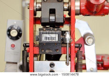 Meter of an old printing machine. Macro photo