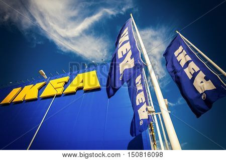SAMARA RUSSIA - SEPTEMBER 9 2015: IKEA flags against sky at the IKEA Samara Store. IKEA is the world's largest furniture retailer