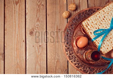 Passover background with matzo and vintage seder plate. View from above