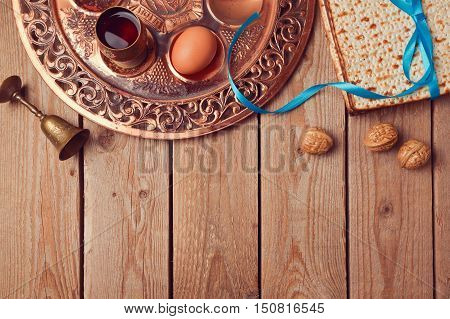 Passover background with matzo wine and old seder plate. View from above