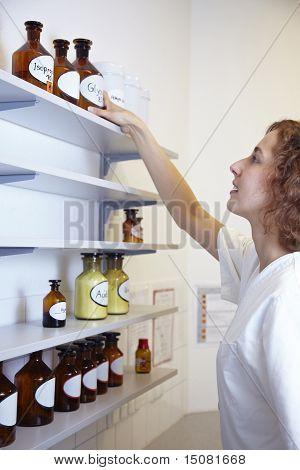 Reaching For Drug Bottle