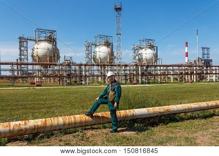 Smiling refinery woman worker on petrochemical factory
