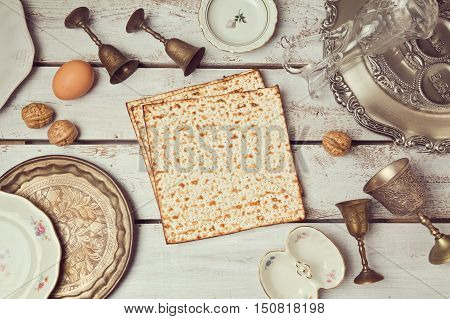 Passover background with matzoh on wooden table. View from above. Flat lay