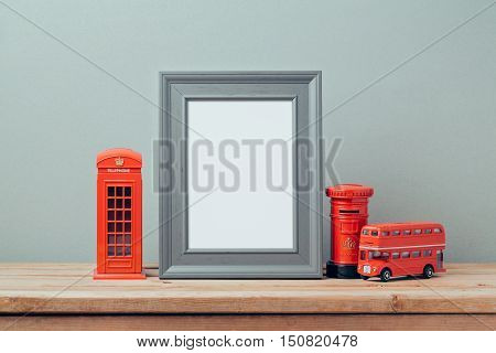 Poster mock up template with London telephone booth and red bus. Travel and tourism concept.
