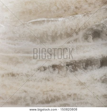 Surface of the mineral moonstone. Patterns and textures for abstract background.