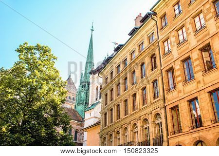 Street view with old buildings and Saint Pierre church's spire in the old town of Geneva city in Switzerland