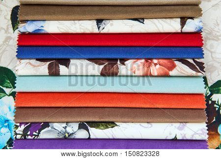 The texture of different fabrics velvet background. Samples of different colors of velvet for use.