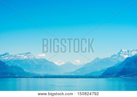 Landscape view on Geneva lake with beautiful mountains in Switzerland