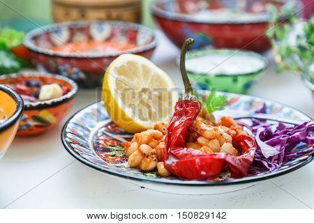 Mediterranian baked white beans with hot pepper.