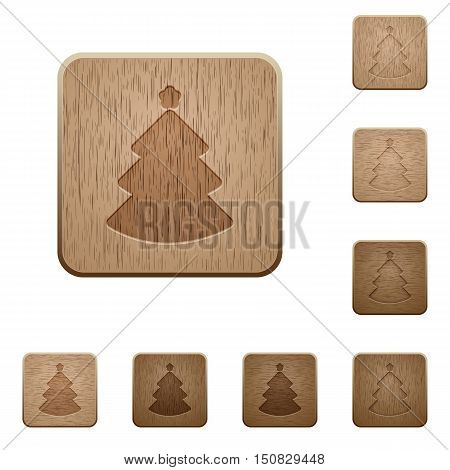 Set of carved wooden Christmas tree buttons in 8 variations.