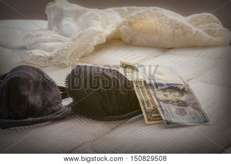 Bra of prostitutes on the couch with her money.
