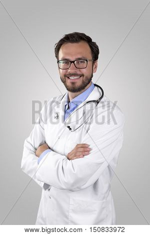 portrait of a smiling doctor on gray background