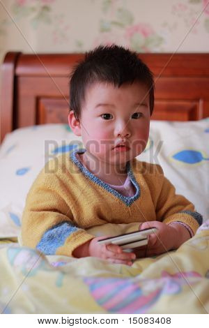 boy play mobile phone
