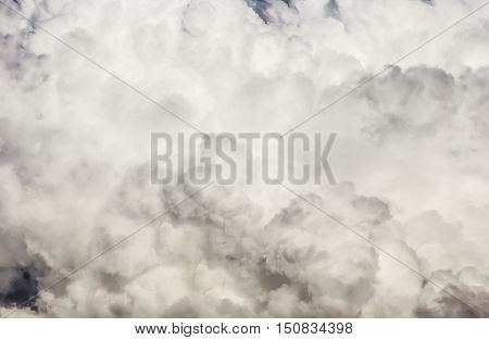 High detail fluffy cumuli cloud textured background