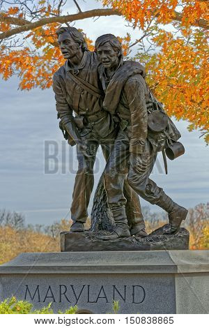 GETTYSBURG PENNSYLVANIA - OCTOBER 31 2015: A bronze statue by Lawrence M. Ludke of two wounded Marylanders one Union and one Confederate helping each other on the battlefield. It was dedicated on November 13 1994.