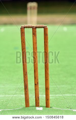 Concept photo of a Cricket pitch with wicket and stump