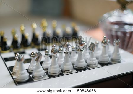 expensive chess board with chess pieces at home