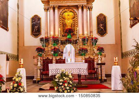 GUANAJUATO, MEXICO - DECEMBER 30, 2014 Basilica Templo De La Compania Christmas Poinsettias Guanajuato Mexico. Built by the Jesuits between 1746 to 1765.