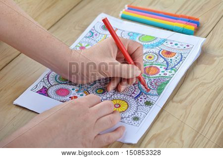 Woman Hands Coloring  Patterns On A Coloring Page For Stress Relie